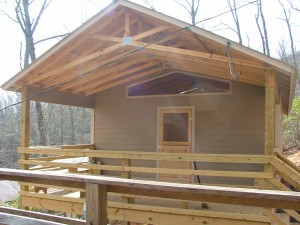 Front, covered porch of new cabin
